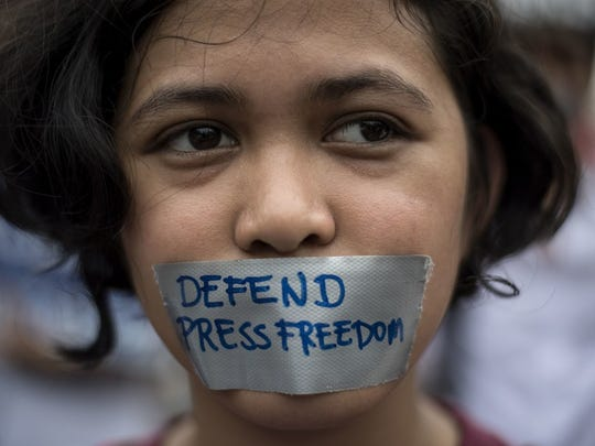 In this file photo taken on January 17, 2018, a college student participates in a protest to defend press freedom in Manila.