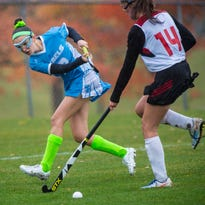 South Burlington's Kimmy Norris, left, hits the ball past CVU's Nathalie Paquette in Hinesburg on Friday, October 21, 2016.