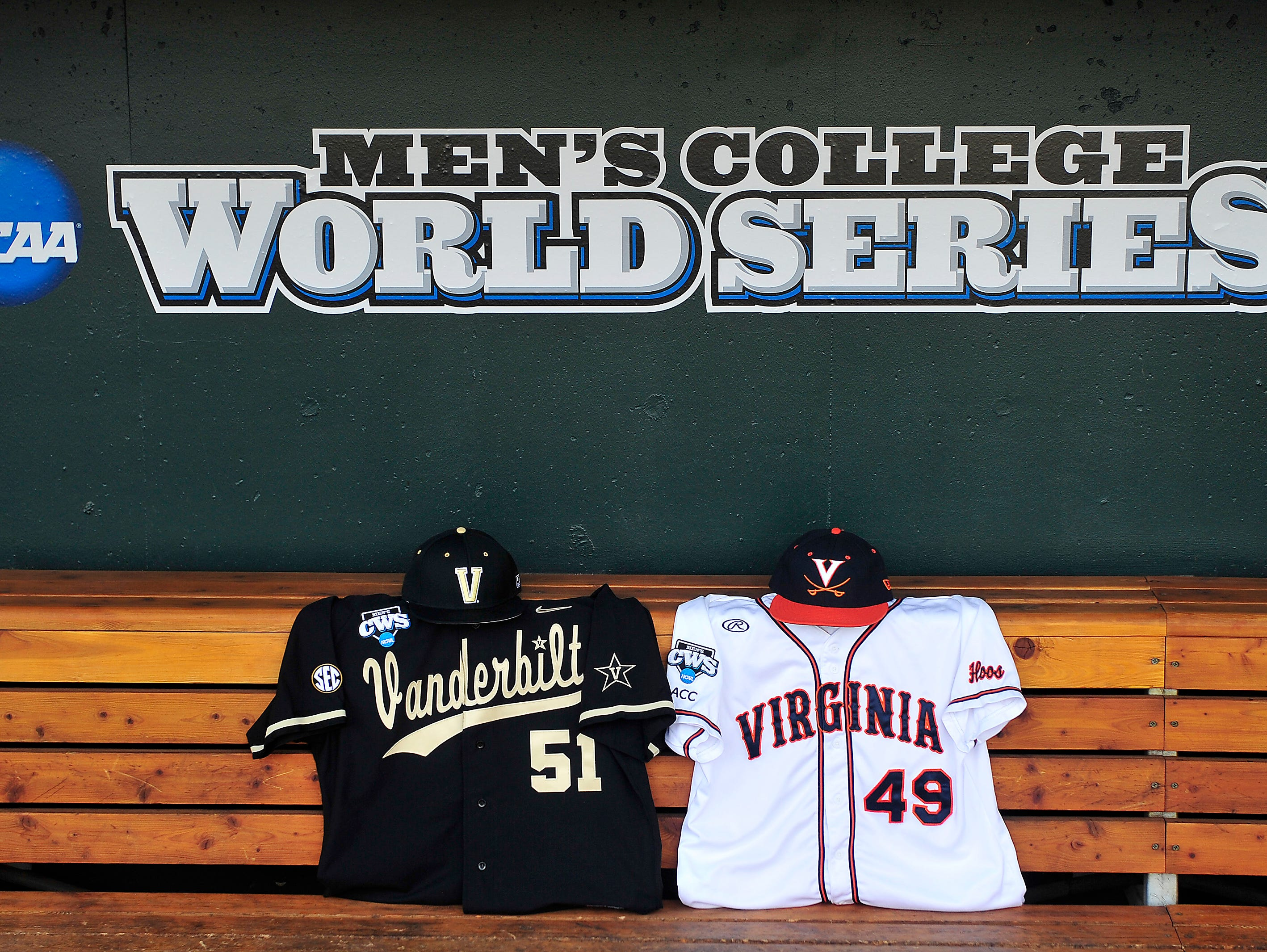 Vanderbilt and Virginia jerseys sit in the bench at the College World Series at TD Ameritrade Park in Omaha, Neb., Wednesday, June 25, 2014.