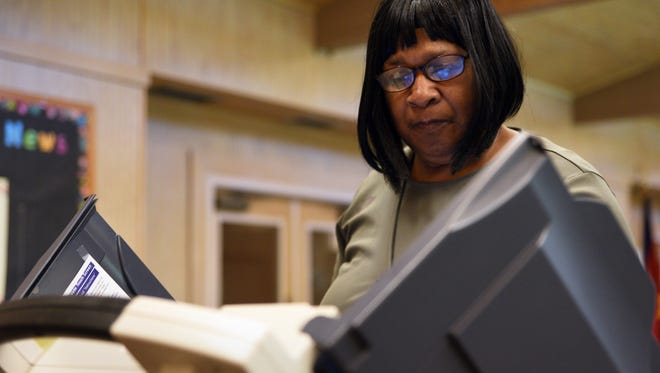 Julia Donald votes in the party runoff elections at the Salvation Army on Tuesday. Runoff winners advance to the Nov. 3 general election.