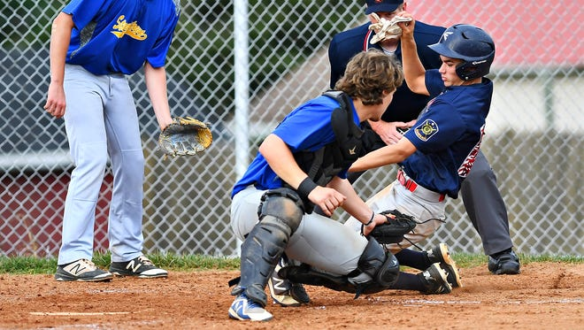 Stewartstown's Garrett Meckley, left, waits at home to tag out Pleasureville's Josh Marquard during York-Adams American Legion baseball action in Springettsbury Township, Wednesday, June 27, 2018. Dawn J. Sagert photo