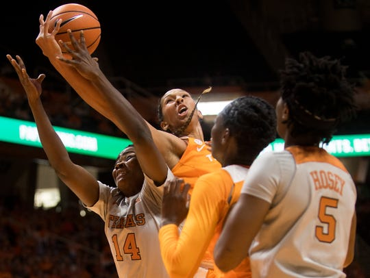 Tennessee center Mercedes Russell (21) and Texas forward