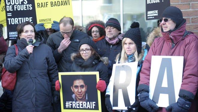 Ensaf Haidar, center, protests Tuesday in Quebec for Saudi Arabia to free her husband, Raif Badawi.