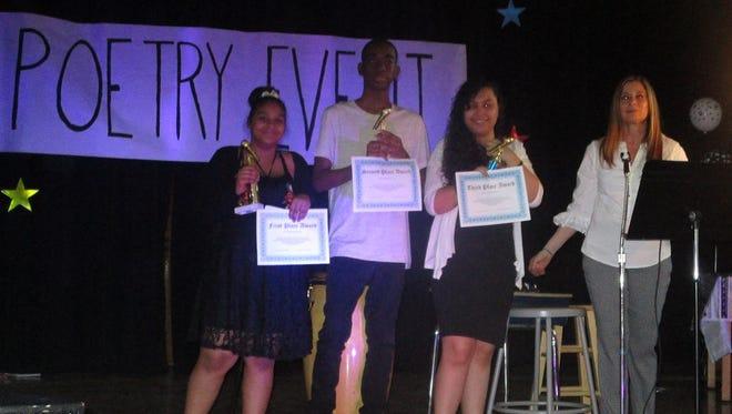 School 18 poetry winners in grades 6-8: Ashley Peralta, Dayshawn Bernard, and Iris Rios with the school's poetry club founder Sandra Nunez