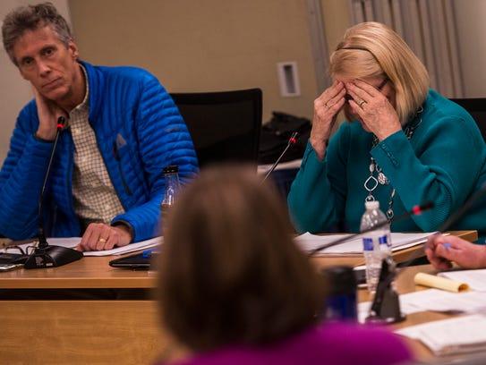 Right, South Burlington city councilor Pat Nowak hangs