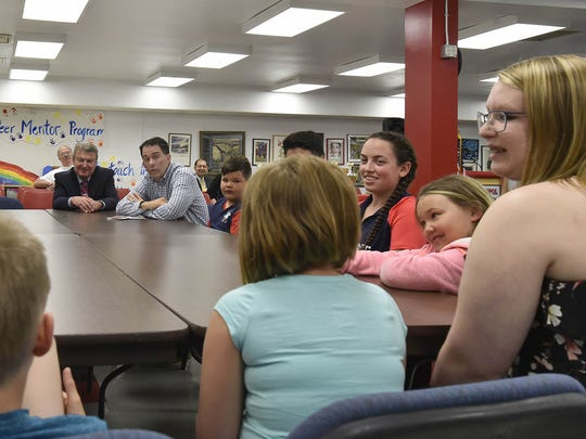 Gov. Scott Walker, background right, conducts a round table discussion with Sevastopol students of different grade levels Tuesday morning. The students told of their learning experiences, talents, expectations and education opportunities. To see a photo gallery of the visit, go to www.doorcountyadvocate.com. Tina M. Gohr/USA TODAY NETWORK-Wisconsin