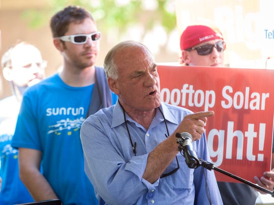 Barry Goldwater Jr., chairman of the group TUSK, or Tell Utilities Solar Won't Be Killed, speaks Wednesday in front of the state Senate building in Phoenix against a proposed tax to be levied against residential solar-leasing companies.