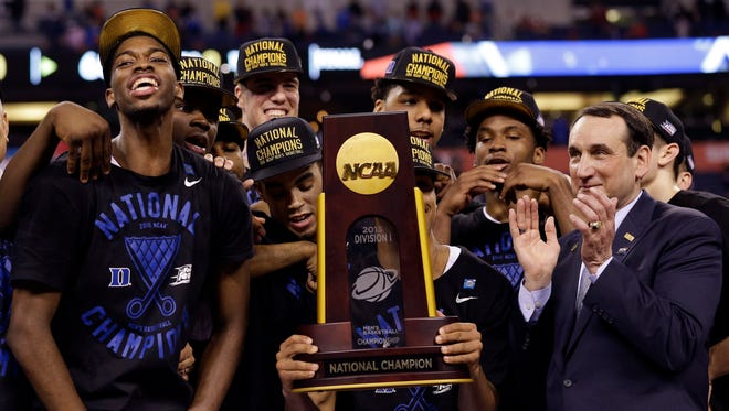 Duke players celebrate with the trophy after their 68-63 victory over Wisconsin in the NCAA championship game Monday.