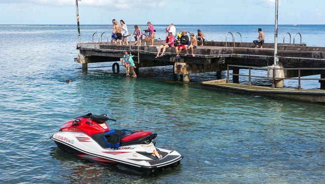 Cocos Lagoon is a home for swimmers and recreational sea vehicles — and fish that may have high levels of toxic PCBs.