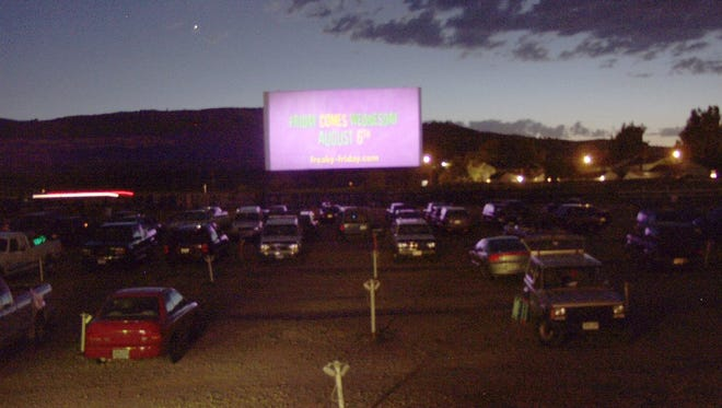 "Movie-goers saddle up to watch ""Charlie's Angels: Full Throttle"" at the Holiday Twin Drive-In in 2001."