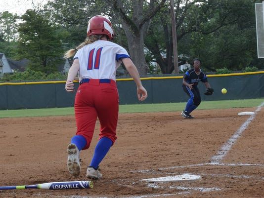 Bolton's Destiny Frazier (24, right) tags first for an out against Jewel Sumner's Destiny Gray (11, left).