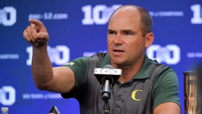 Oregon head coach Mark Helfrich speaks to reporters during NCAA college Pac-12 Football Media Days, Friday, July 31, 2015, in Burbank, Calif.