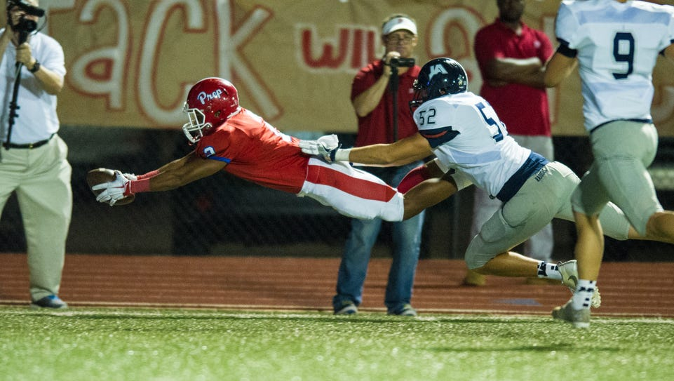 Jackson Prep running back Jerrion Ealy dives for the