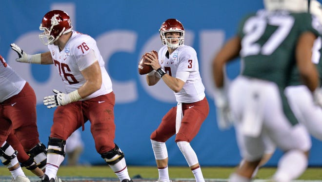 Washington State Cougars quarterback Tyler Hilinski (3) looks to pass during the first quarter against the Michigan State Spartans in the 2017 Holiday Bowl at SDCCU Stadium.