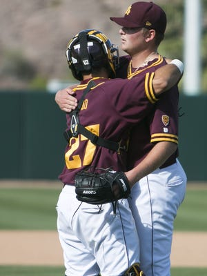 ASU's Ryan Burr, right, is the only pitcher in the nation with double-digit saves and seven wins.