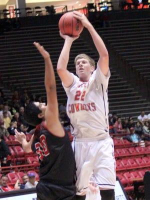 Cliff's Holt Shelley pulls up for a jumper during state basketball championship action against Springer at Wise Pies Arena in Albuquerque on Saturday. He led the Cowboys, with 19 points and 19 rebounds for a double double.