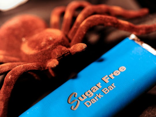 "Even an eight-legged creature may enjoy a sugar-free chocolate candy bar photographed in Hagåtña on Friday, Oct. 7. Even if the wrapper indicates that the candy is ""sugar-free,"" diabetics should always check the amount of total carbohydrates instead of sugars."