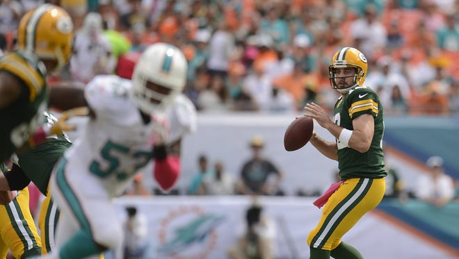Green Bay Packers quarterback Aaron Rodgers (12) looks to make a pass in the first quarter during Sunday's game against the Miami Dolphins at Sun Life Stadium.