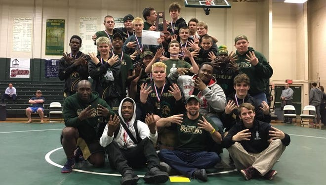 The Lincoln wrestling team captured its eighth consecutive District 2-2A title on Friday, creating a new school record.