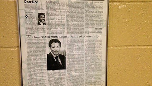 These framed newspaper articles hang in a hall filled