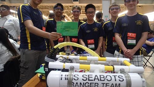 Members of Harrington Middle School's SeaBots Marine Advanced Technology Education (MATE) Ranger team, which finished in third place at the 15th annual International MATE ROV competition last month in Houston. Shown here with their ROV in Houston.