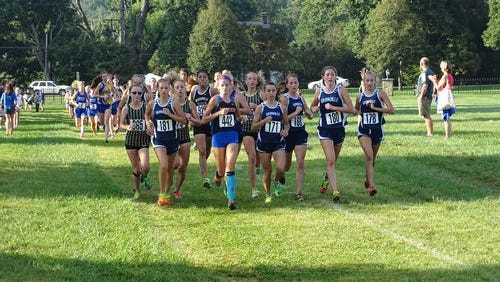 Granville's girls, including Kylee McFarland (front left) and Rosie Lamb (front right), led as a pack in the 2015 Granville Invitational.
