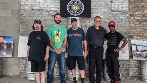 Members of Sly and the Family Stone visited City Lights Brewing. From left is Jerry Martini, brewer Jimmy Gohsman, Greg Errico, David Ryder with City Lights and Jimmy McKinney.