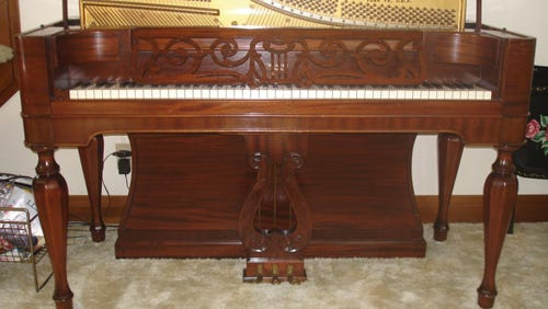 This Weaver Organ & Piano product was made in the Great Depression, when demand for such musical instruments was not high. World War II helped the company – whose empty building stands today on North Broad Street – because the military ordered olive-drab colored pianos for officers clubs and other such uses. Notice the fine wood work above the keyboard.