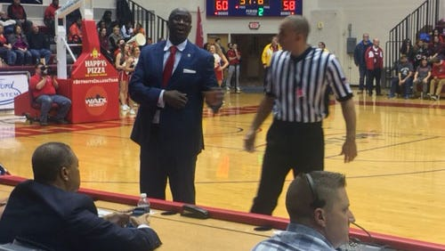 Detroit Mercy coach Baraci Alexander talks to the official during UDM's 73-69 overtime loss to Milwaukee Friday at Calihan Hall.