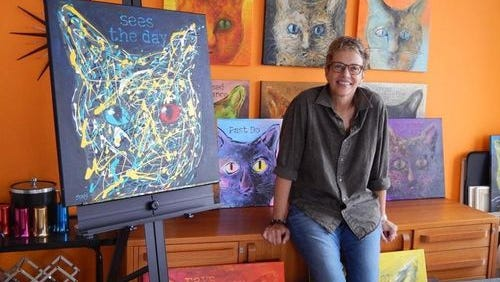 """Jodi SIms' first book, """"Soul Provider,"""" interspersed portraits of her cat with journal entries about her cancer experience."""