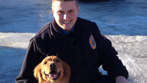 A photo released by the Alaska State Troopers shows Lucas Hegg with his dog, Amber.