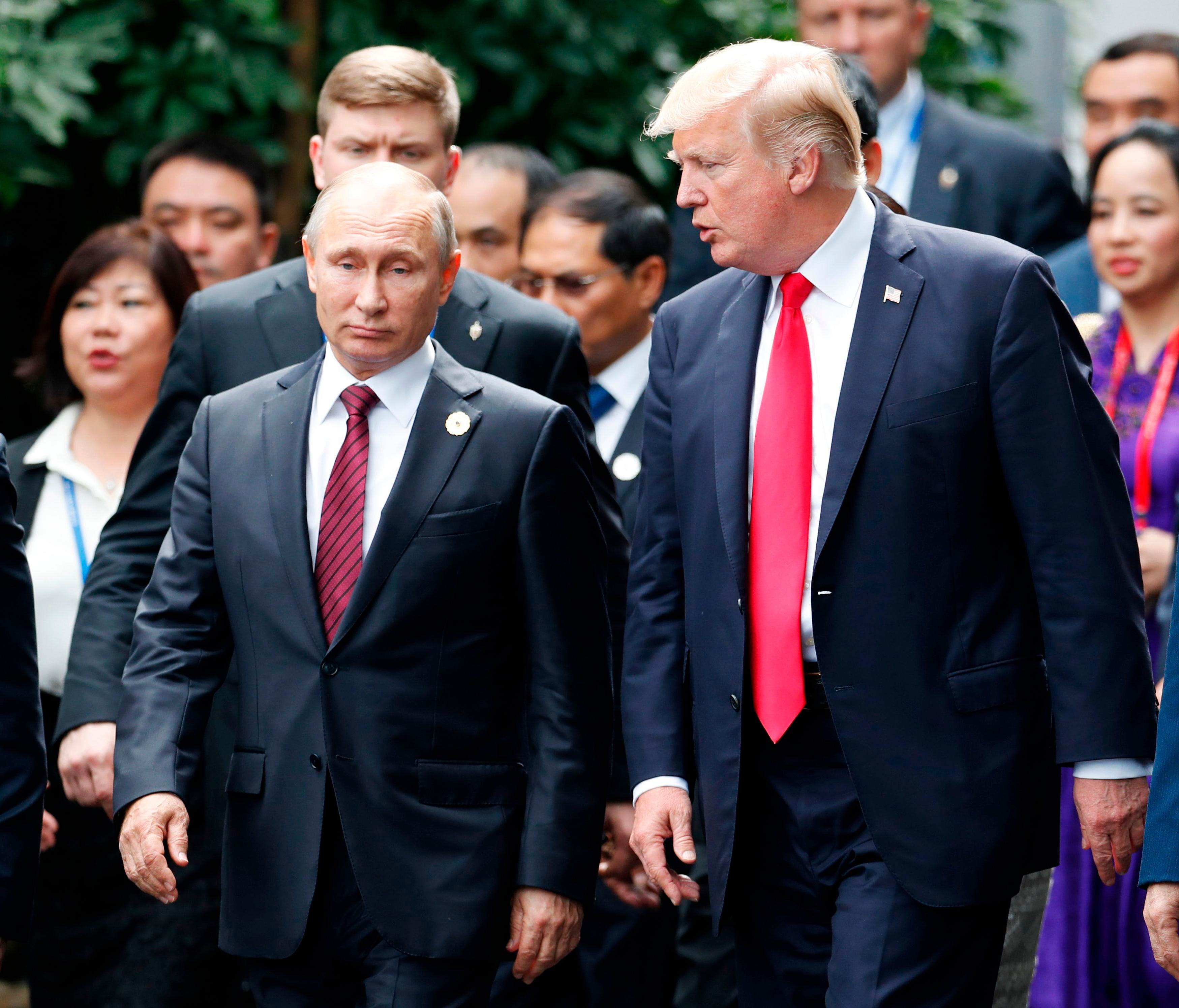 President Donald Trump and Russian President Vladimir Putin during the Asia-Pacific Economic Cooperation leaders' summit.