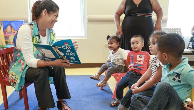"First lady Christine Calvo delivered a shipment of about 200 books to the Southern Region Community Health Center in Inarajan on April 18, in support of the Reach Out and Read Program. She also read Dr. Seuss' ""The Cat in the Hat"" to children in the waiting room."