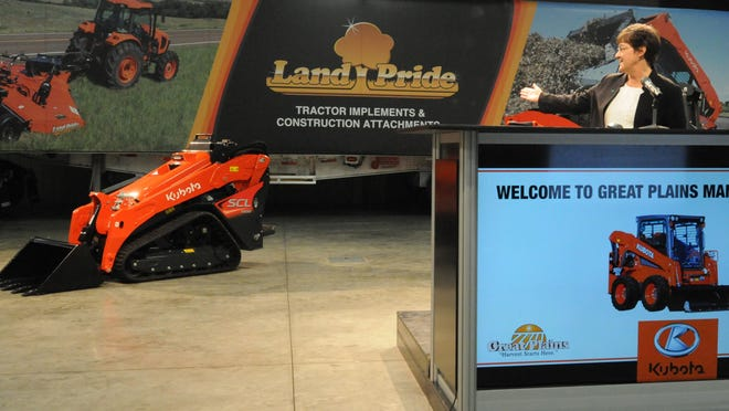 Linda Salem, president of Great Plains Manufacturing, shows off the Kubota Stand-On Track Loader SCL1000 that will be one of the loaders in production in a new Great Plains Manufacturing facility in Salina by the end of 2021. The $53 million expansion project will add about 130 new jobs to the workforce.