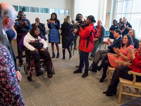 Marquisha Jones, who was paralyzed by a stray bullet, is presented items to help her with her dream of going to law school on Friday February 10, 2017 at Carver High School in Montgomery, Ala.