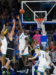 USC Upstate's Michael Buchanan (44) sinks the game-winning shot with less than two seconds left on the clock over FGCU's Demetris Morant (21) in the second half of action at Alico Arena Thursday, Jan. 19, 2017 in Estero. USC Upstate would win 62-60.