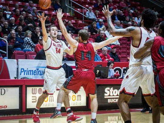 Ball State's Kyle Mallers passes past IU Kokomo's defense