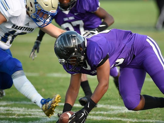 Cane Ridge linebacker Miles Mason (45) recovers a Brentwood fumble during the first quarter at Cane Ridge High School Friday, Aug. 25, 2017 in Nashville, Tenn.