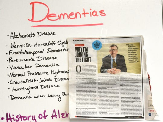 An article announcing Bill Gates donation of $50 million to Alzheimer's research is posted on the production board in Keith Famie's office.