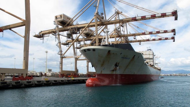 A Maston ship sits in Honolulu Harbor near the site of a molasses spill in Honolulu on Monday, Sept. 16, 2013.