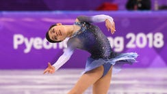 Evgenia Medvedeva performs in the women's figure skating