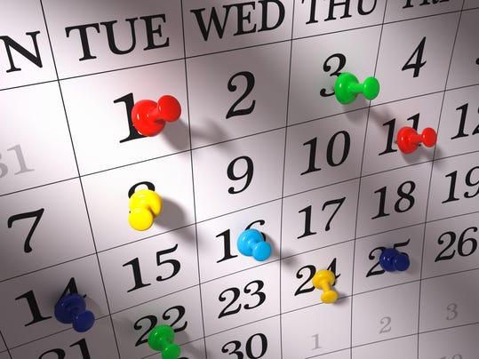 Calendar with pushpins