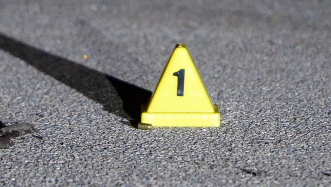 A January 2019 file photo shows a shell casing marked by a yellow placard in Brockton.