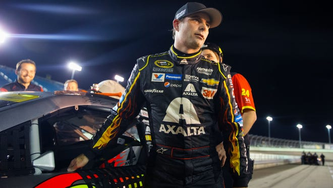 NASCAR Sprint Cup Series driver Jeff Gordon pauses during qualifying for the Ford Ecoboost 400 at Homestead-Miami Speedway.