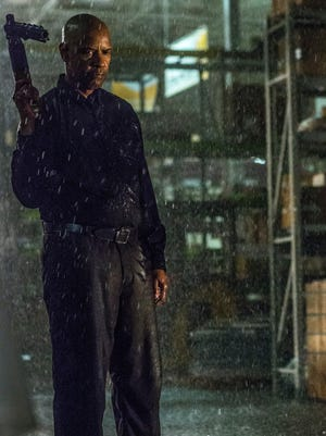 Denzel Washington as Robert McCall, a a former black ops commando who comes out of retirement to save a young woman in trouble with the Russian mob in 'The Equalizer.'