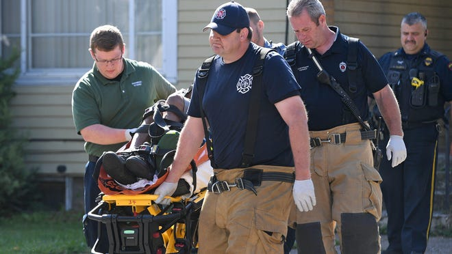 Emergency personnel remove a patient from a residence in the 600 block of East 25th Street in Erie following a possible drug overdose on Aug. 20, 2019. Erie Police Chief Dan Spizarny said a recent review of police calls shows that reported overdoses have increased in Erie and Erie County so far this year over the same period in 2019.