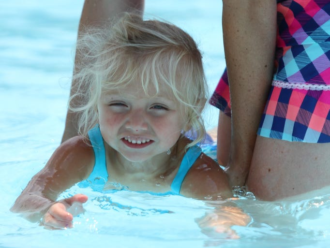 Familes enjoying the day at the Highland Park Pool in Endwell. The pool is open daily from 1-8 p.m. this summer.