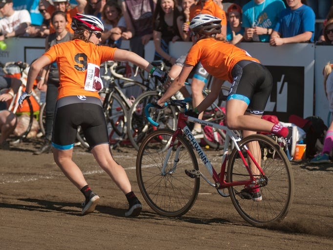 CSF riders perform a rider exchange during the women's Little 500 at Bill Armstrong Stadium in Bloomington, Friday, April 25, 2014.