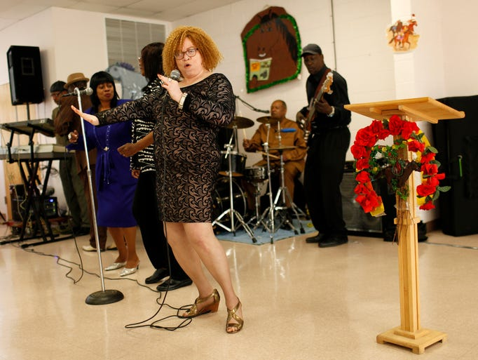 Bridget Randolf, center, performs with The Louisville Connection Band at the Shawnee Friends of the Library 29th annual Derby Fever party at Immaculate Heart of Mary Church. The event, entitled ÒDerby FeverÕs Set to Go: EverybodyÕs Ready to Win, Place and Show,Ó drew approximately 200 people and included lunch, live music, a raffle and fashion show.  April 17, 2014