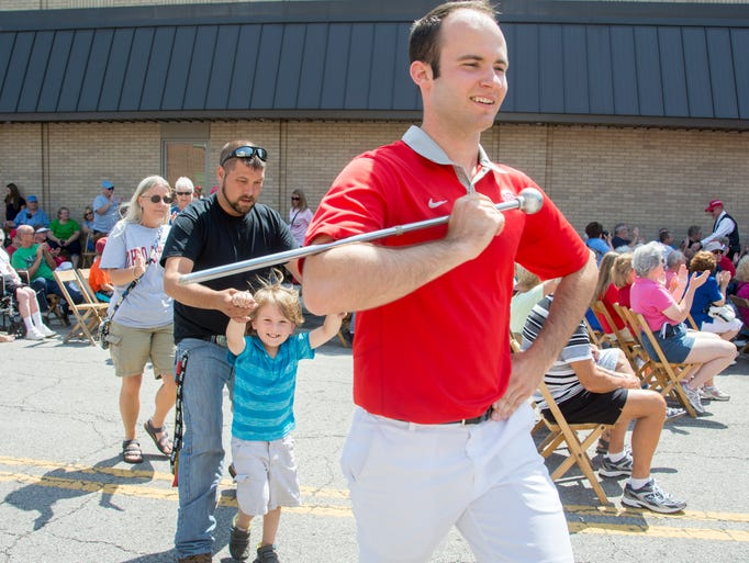 Day three of the Bucyrus Bradwurst Festival included the OSU Alumni Band and parade. David Pettit, OSU drum major in 2013 and 2014 leads the Script Bucyrus during the performance of the OSU Alumni Band.